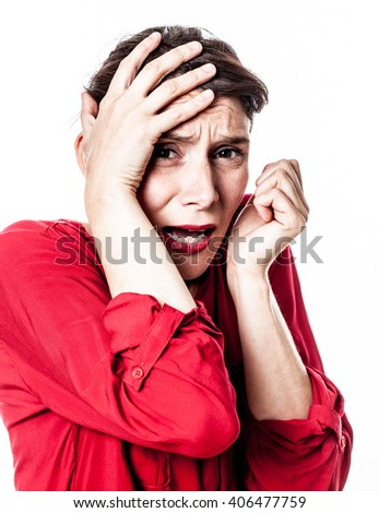 closeup portrait of fear - scared young woman protecting herself against frightening stress and violence with hand gesture, contrast effects over white background studio - stock photo