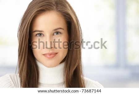 Closeup portrait of female face, attractive woman smiling at camera, copyspace.? - stock photo