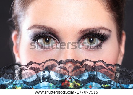 closeup portrait of flamenco dancer with fan - stock photo