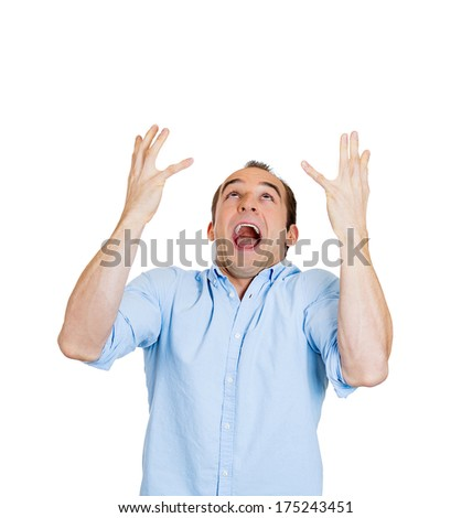 Closeup portrait of frustrated young man fed up with the world, hands in air looking up screaming, isolated on white background. Negative emotion facial expression feelings, reaction, perception - stock photo