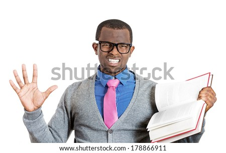 Closeup portrait of frustrated young man who goes against dogma he read in book, has his own opinion about topic, isolated on white background. Negative emotion facial expression feelings. - stock photo