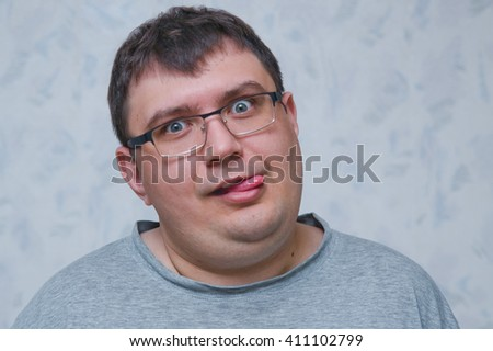 Closeup portrait of funny angry young childish rude bully man  - stock photo