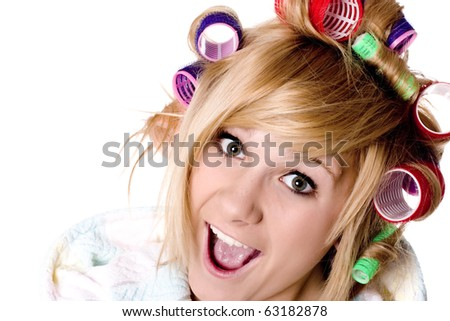 closeup portrait of funny housewife with curlers on white - stock photo