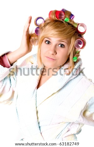 closeup portrait of funny housewife with curlers on white background - stock photo
