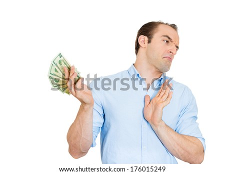 Closeup portrait of funny looking young man with attitude tossing, denying rejecting dollar bills as if he doesn't need your worthless money, isolated on white background. Emotions, facial expressions - stock photo