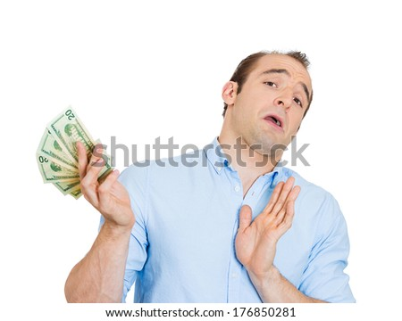 Closeup portrait of funny looking young man with attitude tossing, denying rejecting dollar bills as if he has no need your worthless money, isolated on white background. Emotions, facial expressions - stock photo