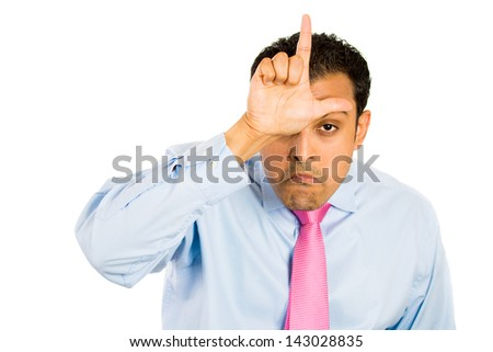 Closeup portrait of funny man displaying a loser sign on his forehead, isolated on a white background - stock photo