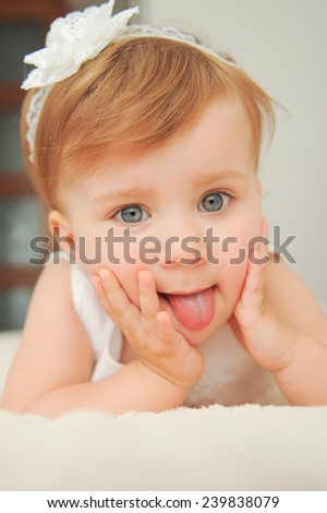 closeup portrait of girl lying in bed - stock photo
