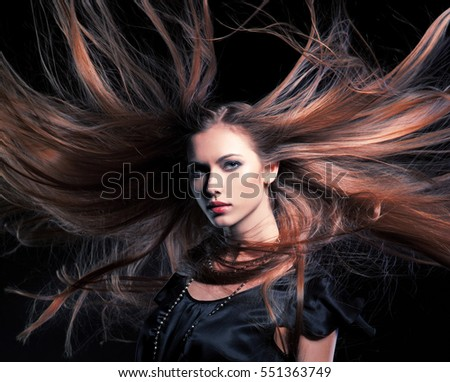 closeup portrait of glamour young girl with beautiful long hair