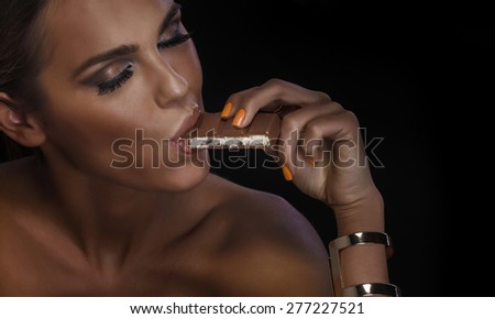 Closeup portrait of gorgeous woman with chocolate. Emotional photo. - stock photo