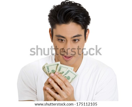 Closeup portrait of greedy man, corporate business employee, worker, student holding dollar banknotes tightly isolated on white background. Negative human emotion, facial expression, feeling, attitude