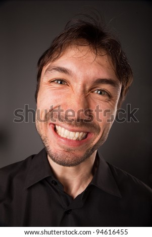 closeup portrait of grimacing man in black shirt - stock photo