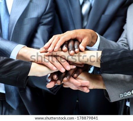 Closeup portrait of group of business people with hands together