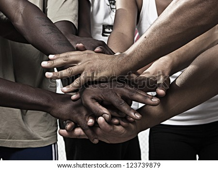 Closeup portrait of group with mixed race people with hands together - stock photo