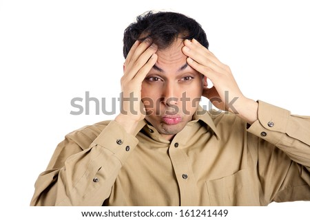 Closeup portrait of guy in brown shirt overwhelmed with work, hands on forehead, isolated on white background. Negative human emotion facial expressions. - stock photo