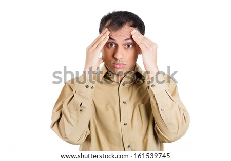 Closeup portrait of guy in brown shirt overwhelmed with work, hands on forehead looking at camera gesture, isolated on white background. Negative human emotion facial expressions. - stock photo