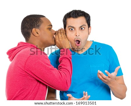 Closeup portrait of guy whispering into man's ear telling him something secret and disturbing. Shocked surprised disbelief wide open mouth response. Negative human emotions facial expression feelings - stock photo
