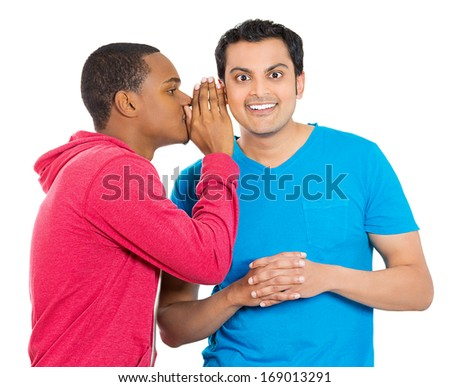Closeup portrait of guy whispering into man's ear telling him something secret good news. Happy smiling cheerful toothy response. Positive communication human emotions facial expression feelings - stock photo