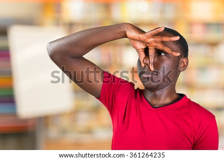 Closeup portrait of handsome african guy closing nose because something stinks - stock photo