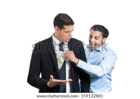 Closeup portrait of handsome agent happily stealing money from a shocked and surprised businessman, isolated on white background. Financial greed concept.  Is your agent taking too much money? - stock photo