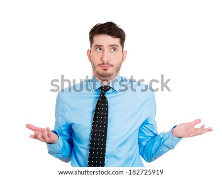 Closeup portrait of handsome business man, worker, student asking what is the problem, who cares, so what, I don't know. Isolated on white background. Human face expressions, attitude, body language - stock photo