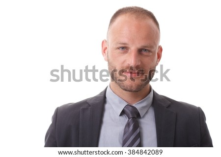 Closeup portrait of handsome businessman with small smile and blue eyes. - stock photo