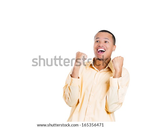 Closeup portrait of handsome happy, screaming young student man winning, arms, fists pumped celebrating success, isolated on white background, space to left. Positive human emotion, facial expressions - stock photo