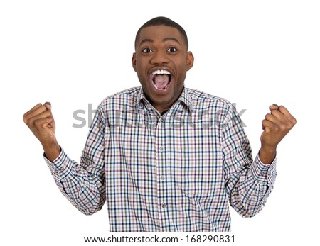 Closeup portrait of handsome happy, screaming young student man winning, arms, fists pumped celebrating success, isolated on white background, Positive human emotion, facial expression feeling - stock photo