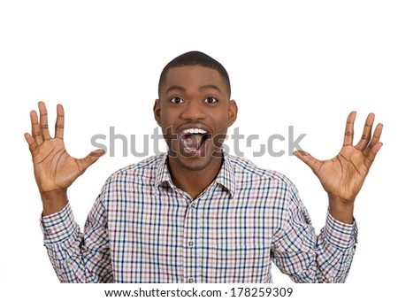 Closeup portrait of handsome happy, screaming young student man winning, arms fists pumped, up in air celebrating success isolated on white background, positive human emotion facial expression feeling - stock photo