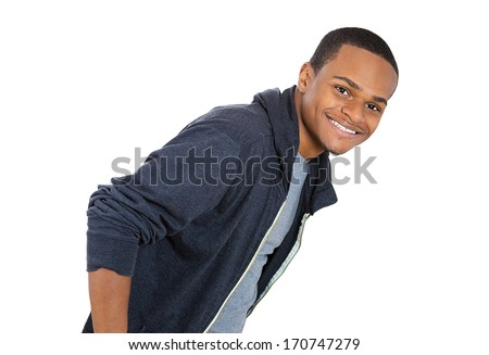 Closeup portrait of handsome happy, smiling young man, confident student, entrepreneur,hands in pockets, isolated on white background. Positive face expressions, emotions, feelings, attitude. - stock photo
