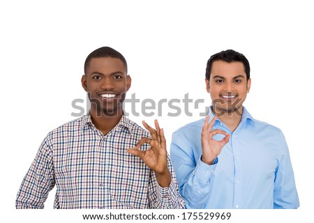 Closeup portrait of handsome happy, young business men showing okay sign gesture symbol, isolated on white background. Positive facial expressions, emotions, feelings, attitude.