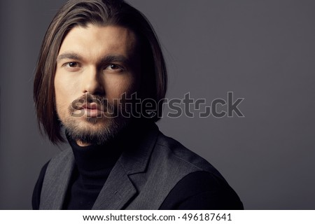Closeup portrait of handsome male model in studio