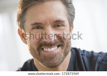 Closeup portrait of handsome mature man smiling - stock photo