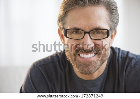Closeup portrait of handsome mature man wearing glasses - stock photo