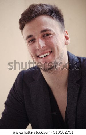 Closeup portrait of handsome mid-adult man smiling at camera.