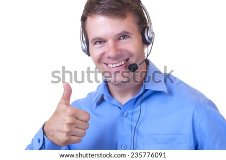 Closeup portrait of handsome smiling Caucasian man wearing blue collared shirt and communications headset giving thumbs up on white background - stock photo