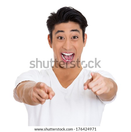 Closeup portrait of handsome surprised, funny young man, worker, student, employee, pointing at you with two index fingers laughing isolated on white background. Human face expression emotion reaction - stock photo