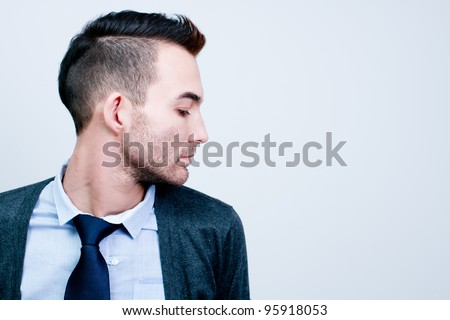 closeup portrait of handsome young adult man - side view profile - stock photo