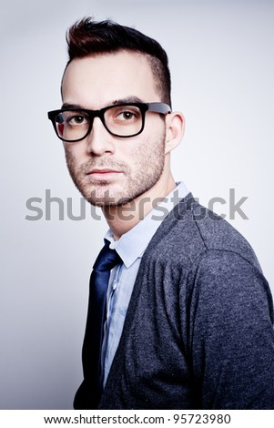 closeup portrait of handsome young adult man wearing glasses - stock photo