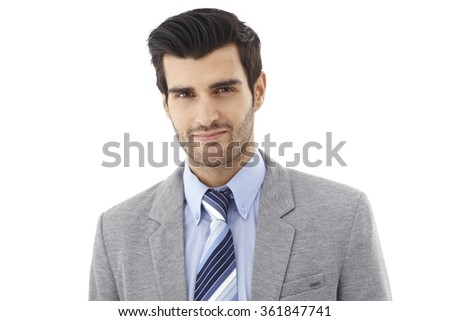Closeup portrait of handsome young businessman, looking at camera, smiling. - stock photo