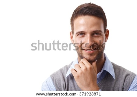 Closeup portrait of handsome young businessman smiling happy, looking at camera, hand on chin. - stock photo