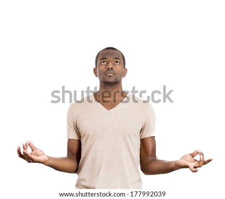 Closeup portrait of handsome, young man in meditation zen mode opened eyes, isolated on white background. Stress relief techniques concept. Positive human emotions, facial expressions, attitude signs - stock photo