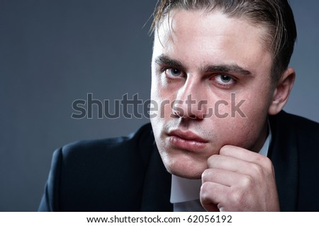 Closeup portrait of handsome young man in suit - stock photo
