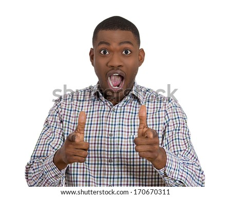 Closeup portrait of handsome young man pointing two guns hand sign gesture stunned dumbstruck dumbfounded looking at camera gesture, isolated on white background. Human emotions facial expression - stock photo
