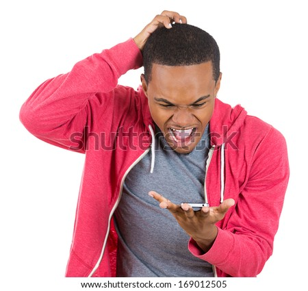 Closeup portrait of handsome young man shocked surprised, open mouth and eyes, mad by what he sees on his cell phone, isolated on white background. Negative human emotion facial expression feeling - stock photo