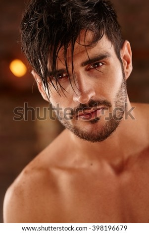 Closeup portrait of handsome young man with bare chest.