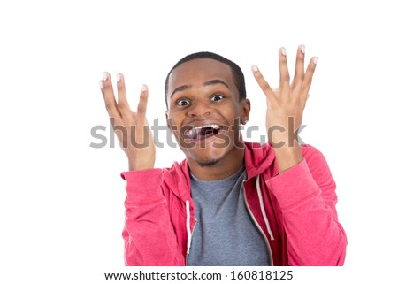 Closeup portrait of handsome young shocked surprised stunned man in red hoody with hands up and mouth open  at camera isolated on white background with copy space. Positive human emotions and signs. - stock photo
