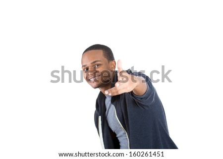 Closeup portrait of handsome young smiling man in black hoody pointing at you isolated on white background with copy space. Positive human emotion facial expression symbols - stock photo