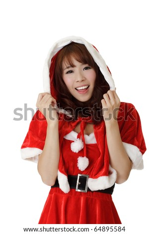 Closeup portrait of happy Asian Christmas girl wear Santa Claus clothes. - stock photo
