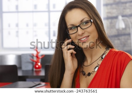 Closeup portrait of happy businesswoman on mobilephone. - stock photo